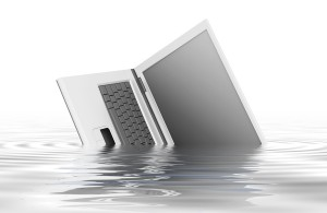 bigstock-The-computer-sinks-in-water-15728288